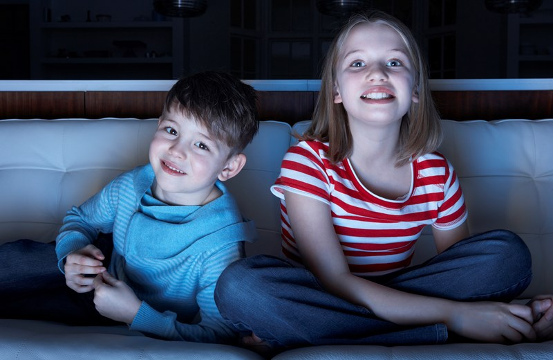 2193977-children-watching-tv-together-sitting-on-sofa.jpg