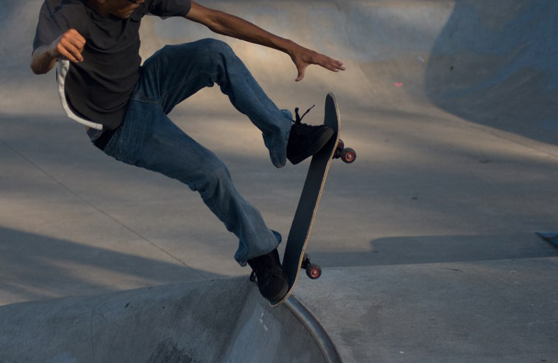 368233-skateboarder-jumping-out-of-the-skatboarding-pit.jpg