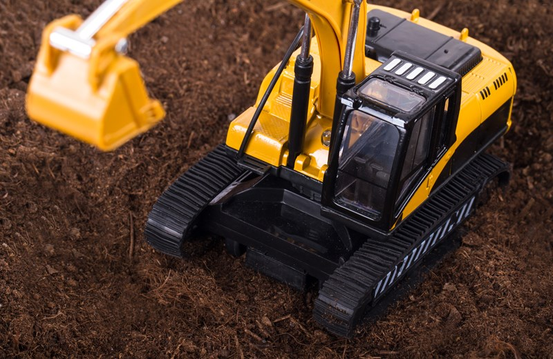 10932111-excavator-detail-on-soil.jpg
