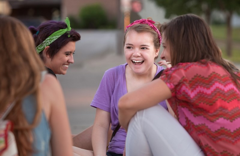 3923777-four-teen-girls-giggling.jpg