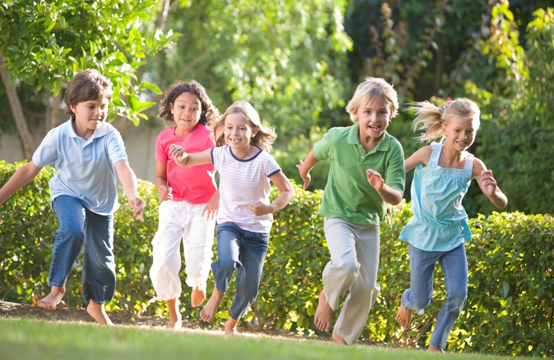 2165925-five-young-friends-running-outdoors-smiling.jpg